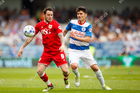 Lee Tomlin of Bristol City and Alejandro Faurlin of QPR during the SkyBet Championship match between QPR and Birmingham City played at Loftus Road Stadium, London on May 7th 2016