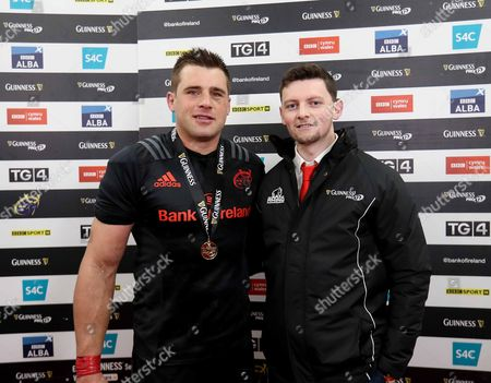 Munster's CJ Stander receives the Guinness PRO12 Man of the Match award from Brian Bennett, Competition Winner on behalf of Guinness