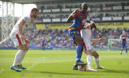Yannick Bolasie of Crystal Palace between Phillip Bardsley and Stephen Ireland of Stoke City during the Barclays Premier League match between Crystal Palace and Stoke City played at Selhurst Park, London on May 7th 2016