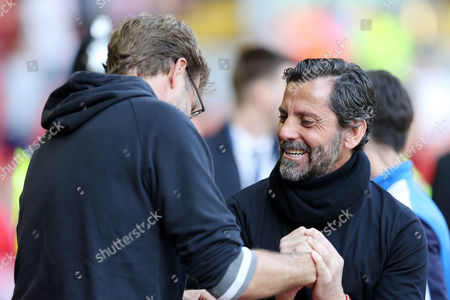 Watford Manager Quique Flores greets Liverpool Manager Jurgen Klopp ahead of the Barclays Premier League match between Liverpool and Watford, played at Anfield, Liverpool, on 08th May 2016