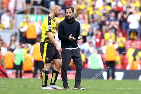 Watford Manager Quique Flores has a conversation with Nordin Amrabat at the end of the Barclays Premier League match between Liverpool and Watford, played at Anfield, Liverpool, on 08th May 2016