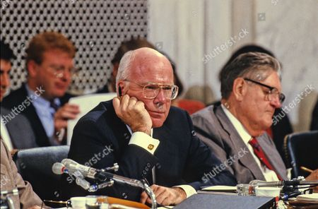 United States Senator Patrick Leahy (Democrat of Vermont) listens to the testimony of Professor Anita Hill before the US Senate Judiciary Committee to confirm Judge Clarence Thomas as Associate Justice of the US Supreme Court in the US Senate Caucus Room in Washington, DC. Thomas was nominated for the position by US President George H.W. Bush on July 1, 1991 to replace retiring Justice Thurgood Marshall. US Senator Howell Heflin (Democrat of Alabama) is seen at the right side of the photo.