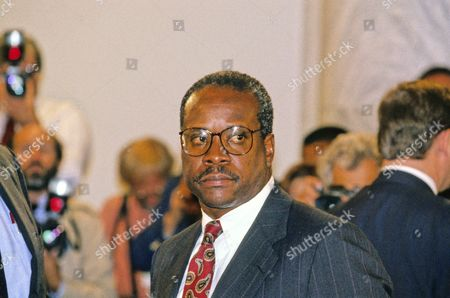Judge Clarence Thomas appears during the hearing before the US Senate Judiciary Committee to hear the testimony of Professor Anita Hill concerning his confirmation as Associate Justice of the US Supreme Court in the US Senate Caucus Room in Washington, DC on September 10, 1991. Thomas was nominated for the position by US President George H.W. Bush to replace retiring Justice Thurgood Marshall.