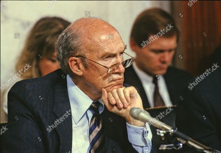 United States Senator Alan Simpson (Republican of Wyoming) listens to the testimony of Professor Anita Hill during the US Senate Judiciary Committee hearings to confirm Judge Clarence Thomas as Associate Justice of the US Supreme Court in the US Senate Caucus Room Thomas was nominated for the position by US President George H.W. Bush on July 1, 1991 to replace retiring Justice Thurgood Marshall.