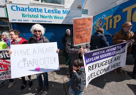 Stock Picture of  Protest by Bristol Defend the Asylum Seekers Campaign outside the constituency office of Charlotte Leslie MP for Bristol North West because of her vote in the House of Commons against the UK taking in 3000 unaccompanied child refugees from the current refugee crisis in the Middle East and the EU. There is another vote next week which the campaigners say gives Leslie a second chance to show some humanity.