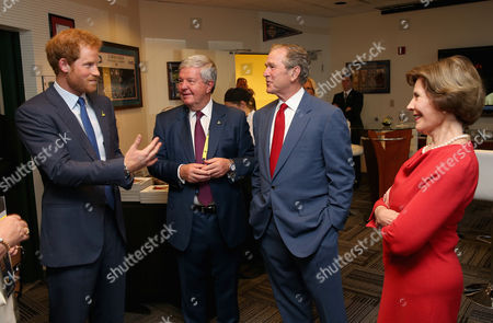 Prince Harry, Sir Keith Mills, George W Bush and Laura Bush chat at a reception