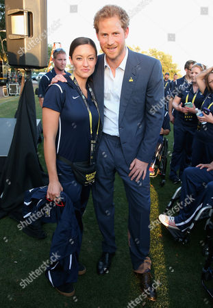 Prince Harry meets USA Invictus Team Member Elizabeth Marks ahead of the Opening Ceremony of the Invictus Games Orlando