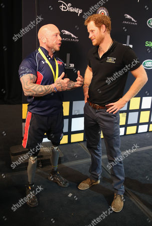 Stock Photo of Prince Harry presents Micky Yule with the Powerlift Gold during the Invictus Games Orlando 2016 at ESPN Wide World of Sports on May 9, 2016 in Orlando, Florida.