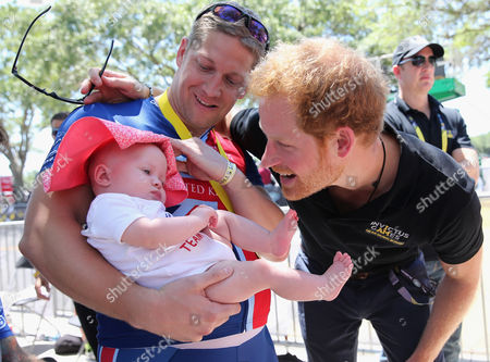Stock Picture of British double gold winner (recumbant cycling) Rob Cromey-Hawke and his daughter Pippa meet Prince Harry at the road cycling event during the Invictus Games Orlando 2016 at ESPN Wide World of Sports on May 9, 2016 in Orlando, Florida.
