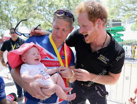 British double gold winner (recumbant cycling) Rob Cromey-Hawke and his daughter Pippa meet Prince Harry at the road cycling event during the Invictus Games Orlando 2016 at ESPN Wide World of Sports on May 9, 2016 in Orlando, Florida.