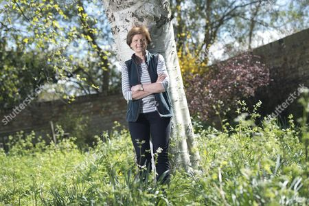 Stock Photo of Dame Fiona Reynolds in the gardens of Emmanuel College, Cambs where she is currently serving as Master