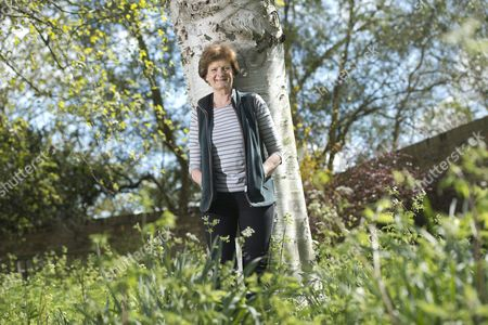 Stock Picture of Dame Fiona Reynolds in the gardens of Emmanuel College, Cambs where she is currently serving as Master