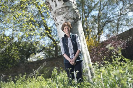 Dame Fiona Reynolds in the gardens of Emmanuel College, Cambs where she is currently serving as Master