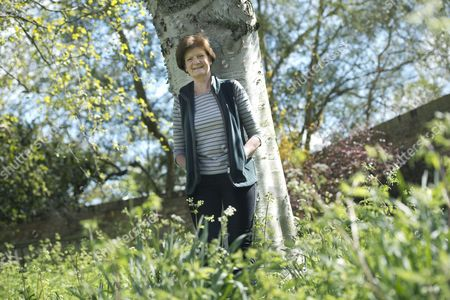 Stock Image of Dame Fiona Reynolds in the gardens of Emmanuel College, Cambs where she is currently serving as Master