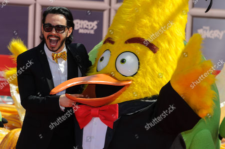 Stock Photo of Timur Rodriguez (the voice of 'Chuck' in the Russian language version) with Angry Birds