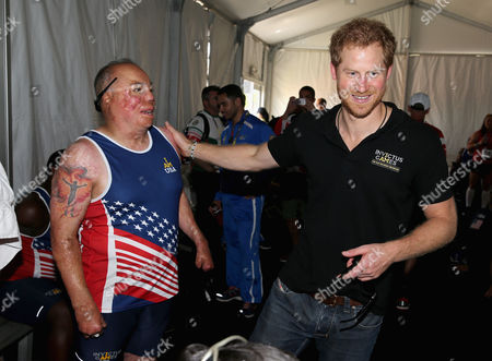 Prince Harry chats to Sgt Israel Del Toro Jr during the Track and Field events during the Invictus Games Orlando 2016 at ESPN Wide World of Sports on May 10, 2016 in Orlando, Florida. Prince Harry, patron of the Invictus Games Foundation is in Orlando for the Invictus Games 2016. The Invictus Games is the only International sporting event for wounded, injured and sick servicemen and women. Started in 2014 by Prince Harry the Invictus Games uses the power of Sport to inspire recovery and support rehabilitation.