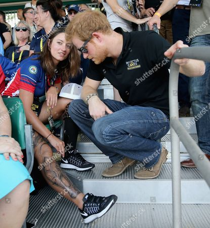Prince Harry chats to USA Invictus Team Member Elizabeth Marks at the track and field events from the crowd during the Invictus Games Orlando 2016 at ESPN Wide World of Sports on May 10, 2016 in Orlando, Florida. Prince Harry, patron of the Invictus Games Foundation is in Orlando for the Invictus Games 2016. The Invictus Games is the only International sporting event for wounded, injured and sick servicemen and women. Started in 2014 by Prince Harry the Invictus Games uses the power of Sport to inspire recovery and support rehabilitation.