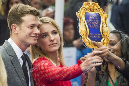 Ed Speleers and partner Asia Macey take a selfie using the electronic looking glass