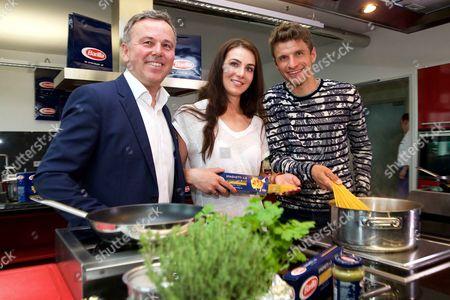 Editorial photo of Thomas Muller and Lisa Muller promote Barilla Pasta, Sky Lounge, Munich, Germany - 10 May 2016