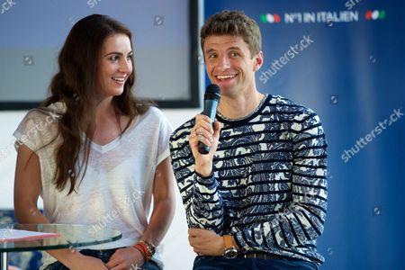 Stock Photo of Lisa Trede and Thomas Muller promote Barilla Pasta