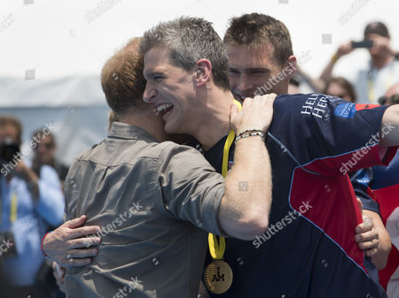 Prince Harry presents British Team Captain David Wiseman with his Gold medal for swimming relay. He competes with a bullet which is permanently lodged in his chest.