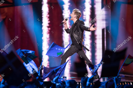 """Justs Sirmais of Latvia performs his song """"Heartbrake"""" at the second semi-final show of the Eurovision Song Contest 2016 in Stockholm, Sweden on May 12, 2016."""