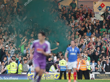 Plymouth Argyle fans set off flares during the match- Mandatory by-line: Paul Terry/JMP