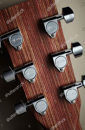 Detail Of The Chrome Enclosed Tuners On A Martin 00x1ae Electro-acoustic Guitar
