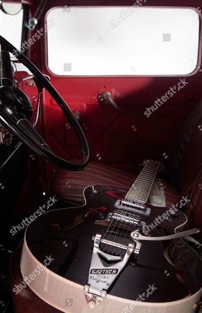 A Gretsch G6120 Brian Setzer Hot Rod Electric Guitar Photographed Inside A Vintage 1933 Ford Pickup