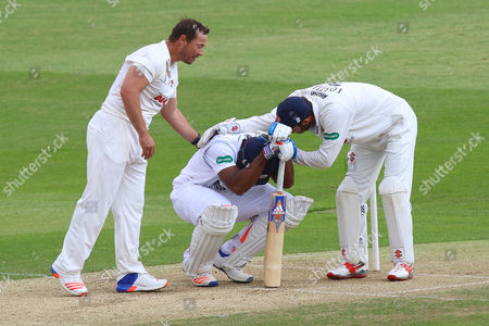 Graham Napier (R) and James Foster of Essex console Chesney Hughes after he is struck by the ball during Essex CCC vs Derbyshire CCC, Specsavers County Championship Division 2 Cricket at the Essex County Ground on 16th May 2016