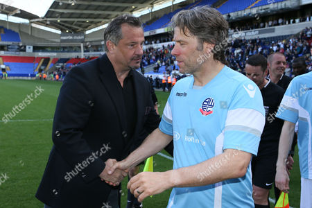 Dean Holdsworth and John Bishop at the end of the legends match between Tony Kelly's All Star Eleven and John McGinlay's All Star Eleven played at the Macron Stadium, Bolton on May 14th 2016