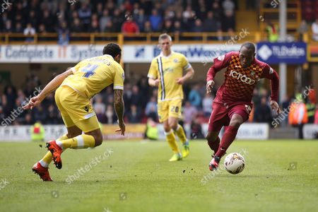 Bradford City midfielder, on loan from Preston North End, Kyel Reid  (17)  takes onMillwall FC midfielder Carlos Edwards (4)  during the Sky Bet League 1 play off first leg match between Bradford City and Millwall at the Coral Windows Stadium, Bradford