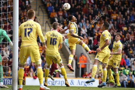 Millwall FC midfielder Carlos Edwards (4)  clears the header during the Sky Bet League 1 play off first leg match between Bradford City and Millwall at the Coral Windows Stadium, Bradford