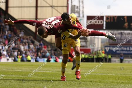 Bradford City forward Jamie Proctor (19)  tangles with Millwall FC midfielder Carlos Edwards (4)  during the Sky Bet League 1 play off first leg match between Bradford City and Millwall at the Coral Windows Stadium, Bradford