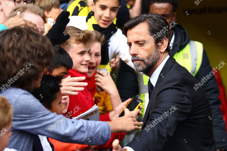 Quique Flores manager of Watford signs autographs   after the Barclays Premier League match between Watford and Sunderland  played at Vicarage Road  , Watford on 15th May 2016