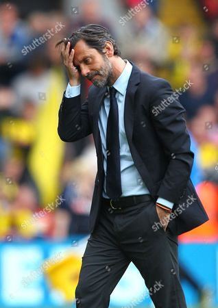 Dejected Quique Flores manager of Watford   during the Barclays Premier League match between Watford and Sunderland  played at Vicarage Road  , Watford on 15th May 2016