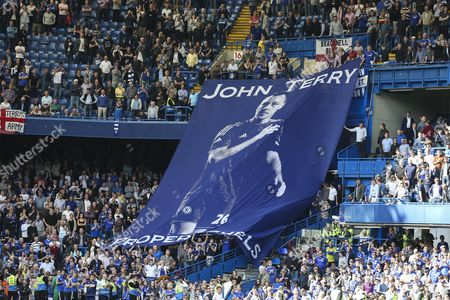 Chelsea fans hold up a hugh John Terry flag for support