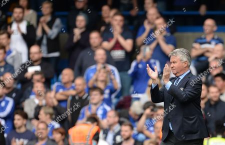 Chelsea Manager Guus Hiddink appauds the fans at full time after the Barclays Premier League match between Chelsea and Leicester City played at Stamford Bridge, London on 15th May 2016