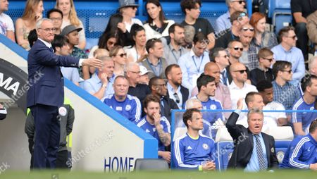 Leicester City manager Claudio Ranieri gestures as Chelsea Manager Guus Hiddink reacts in his seat during the Barclays Premier League match between Chelsea and Leicester City played at Stamford Bridge, London on 15th May 2016