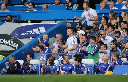 Chelsea bench including John Terry (centre)and Chelsea manager Guus Hiddink (left)celebrate Goal 1-0  during   the Barclays Premier League match between Chelsea and Leicester City played at Stamford Bridge, London on 15th May 2016