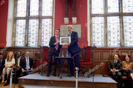 U.S Secretary of State John Kerry poses for a picture with Oxford Union President Robert Harris after Harris presented the Secretary a photo of the Debating Chamber at the Oxford Union