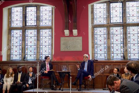 U.S Secretary of State John Kerry answers questions from Oxford Union President Robert Harris in the Debating Chamber at the Oxford Union