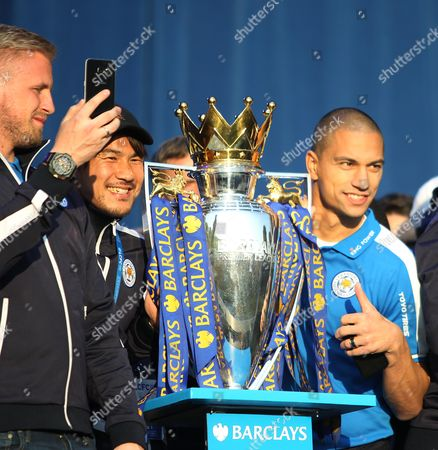 Shinji Okazaki (C) and Gokhan Inler (R) with the trophy at Victoria park during the victory celebrations