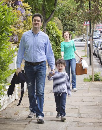 Ed Miliband With One Of His Sons And Wife Justine Thornton. The Milliband Family Arrive Back At Their Family Home In North London.