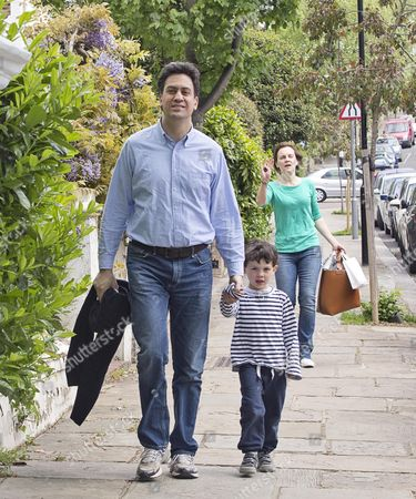 Editorial image of Ed Miliband With One Of His Sons And Wife Justine Thornton. The Milliband Family Arrive Back At Their Family Home In North London.