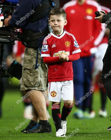 Kai Rooney applauds after the Barclays Premier League match between Manchester United and Bournemouth played at Old Trafford, Manchester on May 17th 2016