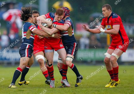 Bristol Rugby Outside Centre Jack Tovey is tackled by Doncaster Knights Flanker Latu Makaafi and Flanker Michael Hills (capt)