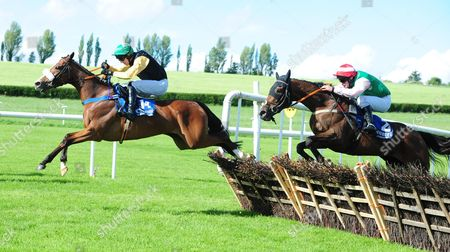 CLONMEL SARAH JOYCE and Mark Walsh (left) beats Artists Daughter (Right) to win the Ancient East Mares Maiden Hurdle. HEALY RACING