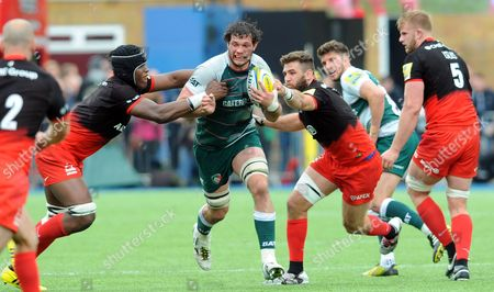 Leicester's Dom Barrow is stopped by Saracens' Maro Itoje and Will Fraser (right)
