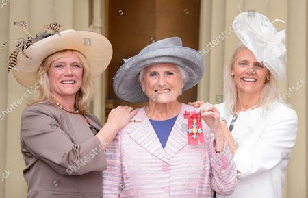 Beryl Vertue receives an CBE with daughters Sue and Debbie